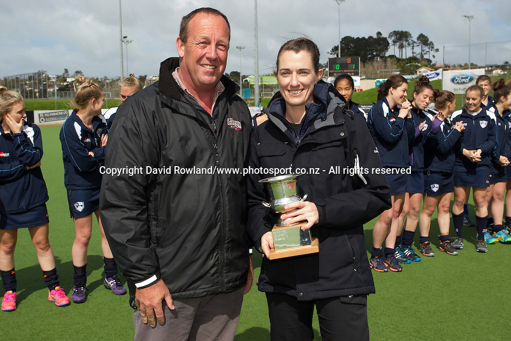 President North Harbour Hockey presents umpire Melanie Oakden with the most valuable umpire of the tournament after the Auckland v Northern Women`s Final match, Ford National Hockey League, North Harbour Hockey Stadium, Auckland, New Zealand,Sunday, September 14, 2014. Photo: David Rowland/Photosport