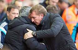 LIVERPOOL, ENGLAND - Saturday, November 8, 2014: Liverpool's manager Brendan Rodgers embraces Chelsea's manager Jose Mourinho during the Premier League match at Anfield. (Pic by David Rawcliffe/Propaganda)