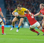 Matt Toomua try to break a tackle during the Rugby World Cup Pool A match between Australia and Wales at Twickenham, Richmond, United Kingdom on 10 October 2015. Photo by Ian Muir.during the Rugby World Cup Pool A match between Australia and Wales at Twickenham, Richmond, United Kingdom on 10 October 2015. Photo by Ian Muir.