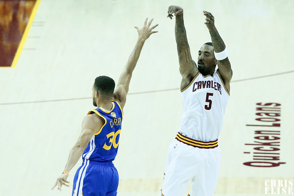 07 June 2017: Cleveland Cavaliers guard JR Smith (5) takes a jump shot over Golden State Warriors guard Stephen Curry (30) during the Golden State Warriors 118-113 victory over the Cleveland Cavaliers, in game 3 of the 2017 NBA Finals, at  the Quicken Loans Arena, Cleveland, Ohio, USA.