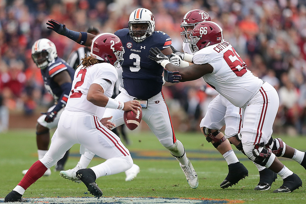 Auburn's Marlon Davidson (3) breaks through the Crimson Tide offensive line as  Alabama's Jalen Hurts (2) scrambles to avoid him. <br /> No. 1 Alabama vs. No. 6 Auburn at Jordan-Hare Stadium in Auburn, Ala. on Saturday, Nov. 24, 2017.<br /> Zach Bland/Auburn Athletics