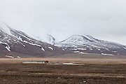 red hut and mountains, Svalbard