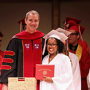 Red Lion Christian Academy candidates for graduation Hannah Kimani  receives her diploma during commencement exercise Friday, May 29, 2015, at Glasgow Church in Bear, Delaware.