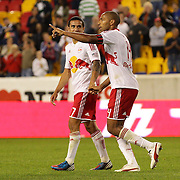 Thierry Henry, New York Red Bulls, celebrates with team mate Tim Cahill after scoring lobbing the Toronto goalkeeper Freddy Hall during his Man of the Match performance during the New York Red Bulls V Toronto FC  Major League Soccer regular season match at Red Bull Arena, Harrison. New Jersey. USA. 29th September 2012. Photo Tim Clayton