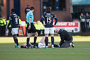 26th December 2017, Dens Park, Dundee, Scotland; Scottish Premier League football, Dundee versus Celtic; Dundee's Josh Meekings gets treatment from physio Gerry Docherty