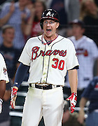 ATLANTA, GA - SEPTEMBER 28:  Second baseman Eliot Johnson #30 of the Atlanta Braves reacts to a ninth inning home run during the game against the Philadelphia Phillies at Turner Field on September 28, 2013 in Atlanta, Georgia.  (Photo by Mike Zarrilli/Getty Images)