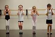 From left, Sophia Bonenfant, 8, of Granite Bay, Dafydd Wynne, 8,  of Sacramento, Taylor Graves, 8, of Sacramento, and Alexander  audition for the Sacramento Ballet's Nutcracker production on Sunday, September 10, 2006. (Photo by Max Whittaker)