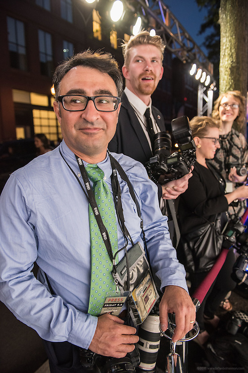 Lexington Herald-Leader staff photographer Pablo Alcala, left, and other still photographers watch for the next celebrity to walk the black carpet at the Vanity Fair Derby party at 21c Museum Hotel. May 6, 2016