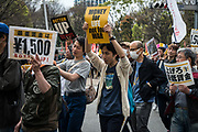 Protesters hold placards demanding a higher wage in Tokyo April 15, 2017, Japan. A Group of young people named Aequitas who means Equity in Latin, organised a demonstration to demanded a minimum hourly wage of 1,500 JPY (approx. USD 13.7), currently the minimum wage ranges from 700 to 900 JPY (approx. USD from 6,4 to 8,3).. 15/04/2017-Tokyo, JAPAN