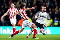 Wayne Rooney of Derby County takes on Joe Allen of Stoke City - Mandatory by-line: Robbie Stephenson/JMP - 31/01/2020 - FOOTBALL - Pride Park Stadium - Derby, England - Derby County v Stoke City - Sky Bet Championship