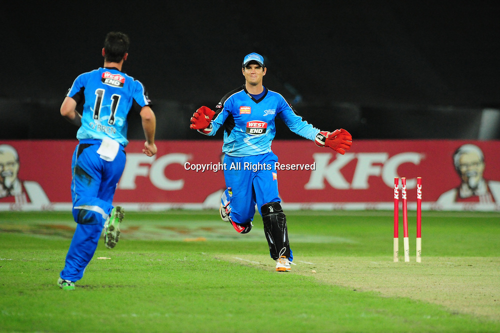23.12.2011 Sydney, Australia. Adelaide Strikers all rounder Aaron O'Brien and Adelaide Strikers wicket keeper Adam Crosthwaite celebrate taking Thunder batsman Usman Khawaja wicket during the KFC T20 Big Bash Cricket League game between Sydney Thunder and Adelaide Strikers at ANZ Stadium Sydney.
