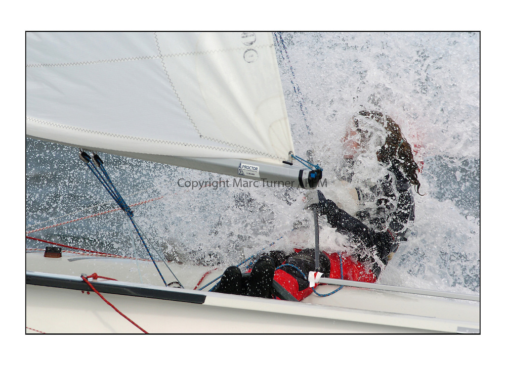 The fourth days racing at the RYA Youth Sailing Championships and Trials held at Largs. Crisp cold Clyde seas break over a 420 helm hiding the crew completely...Pics Marc Turner / PFM