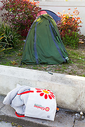 A bag containing what appears to be a grubby duvet lies on the pavement outside the council-owned grounds of Beach House in Worthing, West Sussex, where homeless campers have been living in tents. Worthing, West Sussex, April 30 2019.