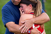 "Hanover-Horton junior Rachel Childs hugs her father Joe after a girls cross country meet Wednesday, 9, 2015, at Springport High School. Twenty five teams competed in the meet. She said she was frustrated two of her teammates passed her during her race. ""If it wasn't for them I wouldn't have gotten a personal record,"" she said. (Nick Gonzales 