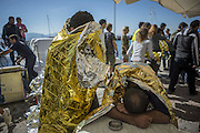 Oct. 15, 2015 - Lesbos Island, Greece - <br /> <br /> European Migrant Crisis<br /> <br /> Refugees and Migrants arrive in the Molyvos port, after greek coastguard vessel hits migrant boat on the Greek Island of Lesbos, on October 15, 2015..More than 400,000 refugees, mostly Syrians and Afghans, arrived in Greece since early January while dozens were drowned trying to make the crossing. In total 710,000 have entered the EU through Greece and Italy during the same period, according to the European Agency Frontex border surveillance. The migration issue has caused deep divisions within the European Union, which is trying to set the distribution of migrants among its member countries or limit the flow.. <br /> ©Exclusivepix Media