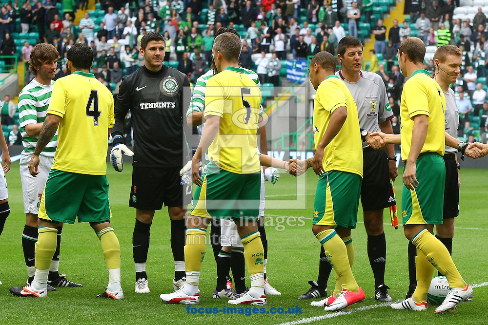 Picture by Paul Chesterton/Focus Images Ltd +44 7904 640267.24/07/2012.The 2 teams shake hands before the Friendly match at Celtic Park, Glasgow.