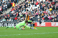 Ahmed Elmohamady of Hull City (right) misses the target after rounding David Martin of Milton Keynes Dons (left) during the Sky Bet Championship match at stadium:mk, Milton Keynes<br /> Picture by David Horn/Focus Images Ltd +44 7545 970036<br /> 31/10/2015