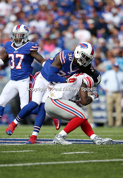 Buffalo Bills strong safety Bacarri Rambo (30) makes a tackle during the 2015 NFL week 4 regular season football game against the New York Giants on Sunday, Oct. 4, 2015 in Orchard Park, N.Y. The Giants won the game 24-10. (©Paul Anthony Spinelli)