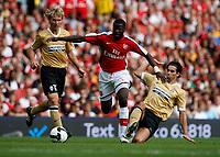 Photo: Richard Lane/Richard Lane Photography. Arsenal v Juventus. Emirates Cup. 02/08/2008. Arsenal's Emmanuel Eboue is tackled by Juventus' Cardoso Mendes Tiago.