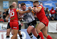 Jake Emmitt of Toronto Wolfpack  tackled by Eloi Pelissier (L) of London Broncos during the Super 8s Qualifiers Million Pound Game at Lamport Stadium, Toronto, Canada<br /> Picture by Stephen Gaunt/Focus Images Ltd +447904 833202<br /> 07/10/2018