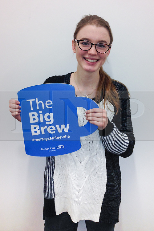 """© Licensed to London News Pictures . 19/01/2015 . Liverpool , UK . Amy Kelly from Coronation Street . Celebrities pose with """" Big Brew """" placards in support of mental health awareness as today (19th January 2015) marks """" Blue Monday """" , the day regarded by many as the most depressing in the year . Campaigners are urging the public to show support by tweeting sefies with their favourite brew and the hashtag """" #brewfie """" . In London , Deputy Prime Minister Nick Clegg , is announcing his campaign to improve mental health awareness , reduce stigma and promote a """" zero ambition """" target for suicide . Photo credit : Joel Goodman/LNP"""