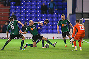 Scunthorpe United defender David Mirfin (6) makes a sliding tackle against Ryan Flynn of Oldham Athletic during the EFL Sky Bet League 1 match between Oldham Athletic and Scunthorpe United at Boundary Park, Oldham, England on 18 October 2016. Photo by Simon Brady.