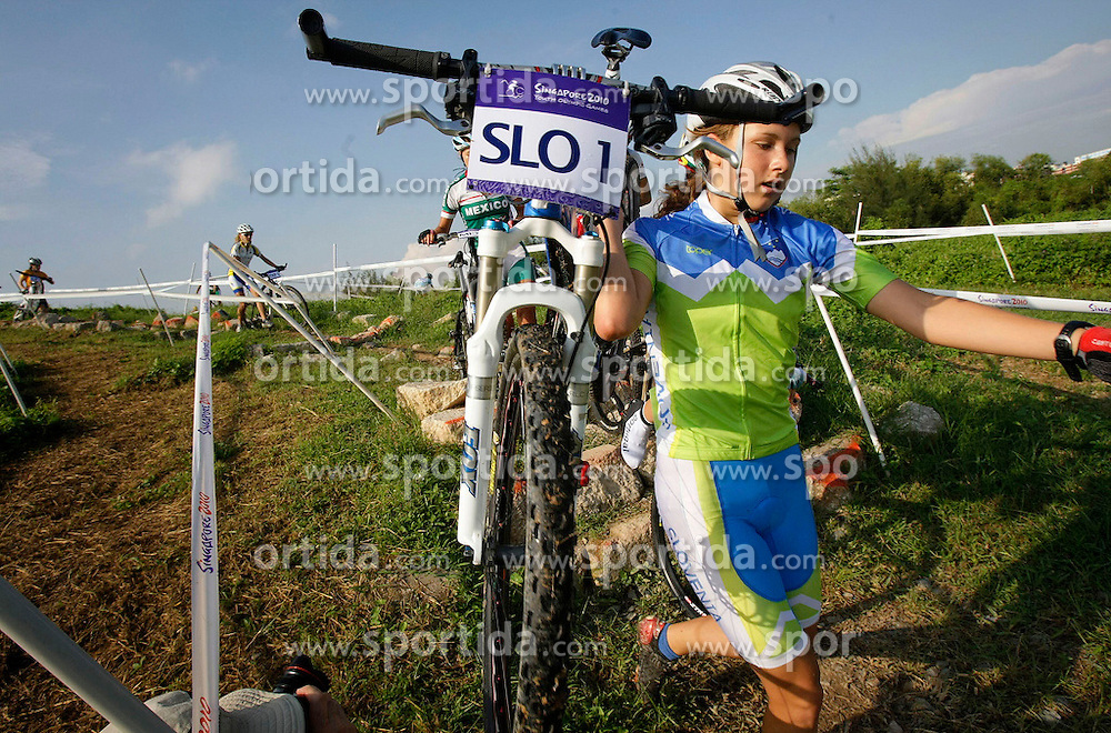 Slovenia's Nika Kozar dismounts her bike and runs down the course in the junior women's cross country of the Singapore 2010 Youth Olympic Games (YOG) at Tampines Bike Park in Singapore, Aug 17, 2010. Photo: SPH-SYOGOC/Kevin Lim. Only for Slovenia.