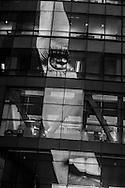 New York , Times square , reuters building. The EYE . mirror game on a buiding. / la tour Reuters a Times square. L' oeil. refletsur un tour miroir