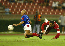 BELGRADE, SERBIA & MONTENEGRO - Wednesday, August 20, 2003: Wales' Gary Speeds gets in a header under pressure from Serbia & Montenegro's Predrag Dordevic  during the UEFA European Championship qualifying match at the Red Star Stadium. (Pic by David Rawcliffe/Propaganda)