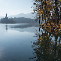 BLED, SLOVENIA - NOVEMBER 01:  The reflection of the sun shines on Bled Lake on November 1, 2015 in Bled, Slovenia. Bled Lake in the Julian Alps is known as one of the most enchanted places in the world and is surrounded by forested mountains, boasts a castle on top of a crag and has an island with a 17th-century church.  (Photo by Marco Secchi/Getty Images)