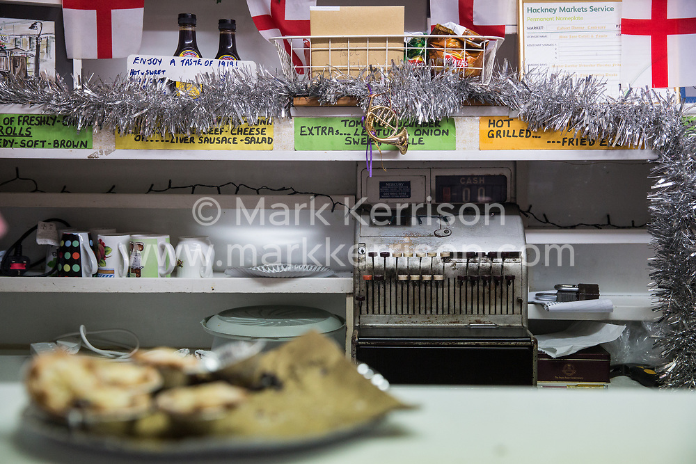 London, UK. 20 December, 2019. A detail of the interior of Syd's Coffee Stall minutes before it closed for business. The mahogany coffee stall, part of east London's history, has been run by three generations of the same family on the corner of Shoreditch High Street and Calvert Avenue since 1919 and will go on display in the new Museum of London in Smithfield in 2024.