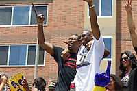 21 June 2010: Kobe Bryant, right, of the Los Angeles Lakers hugs teammate Ron Artest during the Lakers Championship Victory Parade on Figueroa BL. in Los Angeles, CA after the Lakers won the 2010 NBA Championship over the Boston Celtics in Game 7 of the NBA Finals.