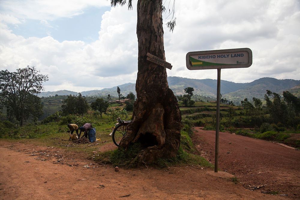 A tourist sign on a dirt road points the way to The Shrine of Our Lady of Sorrows in Kibeho, Rwanda. This is the only sanctioned Marian sanctuary in Africa. Kibeho's overseers and the Rwandan government hope this place will become a top tourism site. <br /> <br /> Photographed on Saturday, October 25, 2014.<br /> <br /> Photo by Laura Elizabeth Pohl