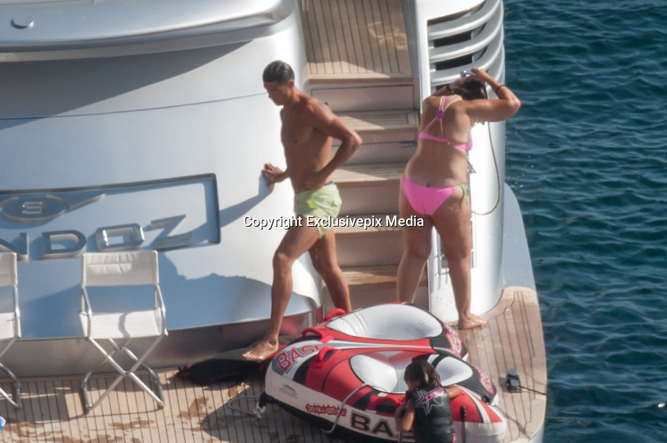 IBIZA, SPAIN, 2016, JULY 13 <br /> <br /> Cristiano Ronaldo with all family Ibiza<br /> <br /> After winning his first European Championship, Cristiano Ronaldo  enjoy a well deserved vacation in the paradisiacal beaches of Ibiza, one of his favorite destinations. The Portuguese striker landed on Tuesday at noon on the island accompanied by his son cristianinho, his mother, Dolores Aveiro and a large group of friends. The whole group enjoyed a fun day at sea where the Real Madrid star showed his most endearing facet. The consecrated footballer took the opportunity to take a refreshing dip.  Wearing a green apple bathing suit, showed off his muscled torso while delighting everyone present with his risky pirouettes to jump into the sea. His son looked excited the spectacle offered by her proud dad<br /> &copy;Exclusivepix Media