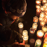 Votive candles are lit during the Feast of Our Lady of Guadalupe celebration annual two-day feast celebration of Mexico's patron saint. Braving extremely cold weather, believers from the Chicago area and other parts of the United States gather day and night to pay homage at the shrine. Photography by Jose More