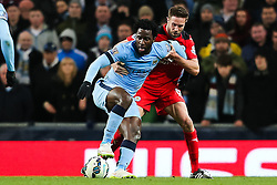 Manchester City's Wilfried Bony holds off Matthew Upson of Leicester City - Photo mandatory by-line: Matt McNulty/JMP - Mobile: 07966 386802 - 04/03/2015 - SPORT - football - Manchester - Etihad Stadium - Manchester City v Leicester City - Barclays Premier League