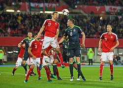 VIENNA, AUSTRIA - Thursday, October 6, 2016: Wales' Andy King in action against Austria's Florian Klein during the 2018 FIFA World Cup Qualifying Group D match at the Ernst-Happel-Stadion. (Pic by David Rawcliffe/Propaganda)