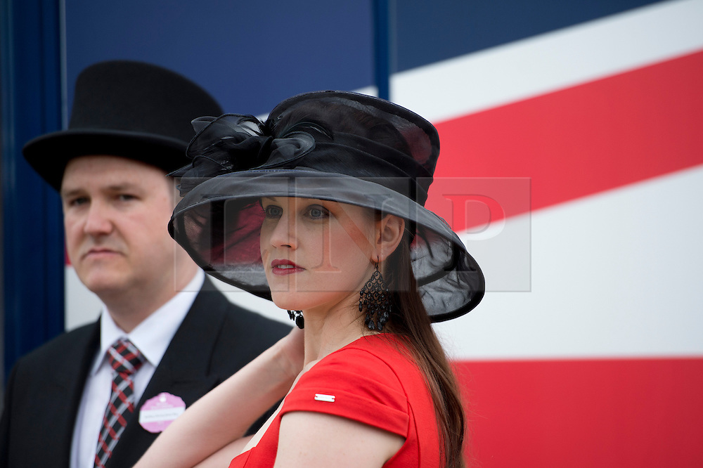 © London News Pictures. 20/06/2013. Ascot, UK.  Ladies Day on day three of Royal Ascot at Ascot racecourse in Berkshire, on June 20, 2013.  The 5 day showcase event,  which is one of the highlights of the racing calendar, has been held at the famous Berkshire course since 1711 and tradition is a hallmark of the meeting. Top hats and tails remain compulsory in parts of the course. Photo credit should read: Ben Cawthra/LNP