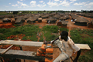 October 7, 2006 - A brick layer constructs a maternity ward in Tetugu camp for internally displaced people, or IDP, near Gulu in north Uganda. Tetugu, with a population of 22,000, is one of 76 IDP camps around Gulu, the main base for the Uganda Peoples Defense Force fighting the insurgent Joseph Kony's Lord's Resistance Army. Kony's LRA movement has been fighting for the past 20 years to force the East African country to be ruled according to the Christian Ten Commandments. Over 2 million people, mostly of the Acholi tribe, have moved or were forced to move from their villages to camps close to the towns of Gulu, Lira, and Kitgum where they are watched over by the Ugandan Army. The LRA rebels have abducted thousands of children and have forced them to fight against the Ugandan Army and the Acholi people. Current peace talks between Kony's LRA and the Ugandan government held in Juba, southern Sudan, offer a glimpse of hope to ending this ongoing conflict..(Photo by Jakub Mosur/Polaris)<br />
