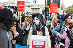 "London, October 31 2017. PICTURED: A woman carries a box containing a petition with 82,965 signatures to be delivered to MPs. Working mothers' rights group Pregnant Then Screwed holds a March of the Mummies demonstration, marching from Trafalgar Square to Parliament Square, demanding ""recognition, respect and change for working mums"". © Paul Davey"
