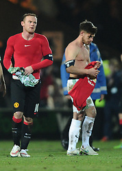 Manchester United's Wayne Rooney takes the shirt of Yeovil Town's Joe Edwards  - Photo mandatory by-line: Joe meredith/JMP - Mobile: 07966 386802 - 04/01/2015 - SPORT - football - Yeovil - Huish Park - Yeovil Town v Manchester United - FA Cup - Third Round