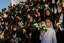Palestinian brides sit during a mass wedding ceremony in the southern Gaza strip city of Rafah, December 19, 2012. Photo by Imago / i-Images...UK ONLY