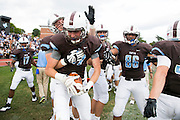 09/20/2014 - Somerville, Mass. - Tufts WR Jack Cooleen, A16, celebrates on the sideline after recovering an insides kick late in the fourth quarter to seal Tufts' 24-17 win over Hamilton at Zimman Field on Sept. 20, 2014. The win snapped a 31-game losing streak. (Kelvin Ma/Tufts University)