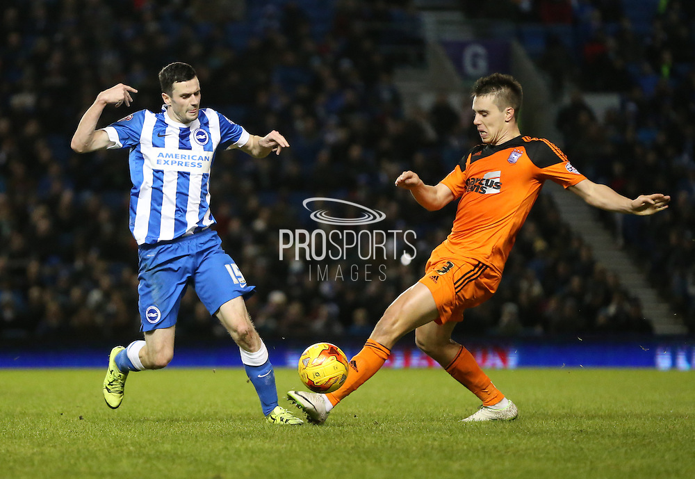 Ipswich Town defender Jonas Knudsen (3) and Brighton winger, Jamie Murphy (15) during the Sky Bet Championship match between Brighton and Hove Albion and Ipswich Town at the American Express Community Stadium, Brighton and Hove, England on 29 December 2015.