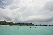 Racers in the distance prone race on Day 1 of the Ironmana in Bora Bora, a popular island in French Polynesia (the Tahitian Islands.)
