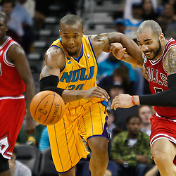 February 12, 2011; New Orleans, LA, USA; Chicago Bulls power forward Carlos Boozer (5) and New Orleans Hornets power forward David West (30) scramble for a loose ball during the third quarter at the New Orleans Arena.  The Bulls defeated the Hornets 97-88. Mandatory Credit: Derick E. Hingle