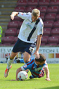 Steve Morison  tussels with Sean McAllister  during the Sky Bet League 1 match between Scunthorpe United and Millwall at Glanford Park, Scunthorpe, England on 22 August 2015. Photo by Ian Lyall.