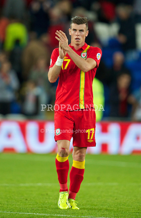 CARDIFF, WALES - Tuesday, September 10, 2013: Wales' Gareth Bale looks dejected after his side's 3-0 defeat by Serbia during the 2014 FIFA World Cup Brazil Qualifying Group A match at the Cardiff CIty Stadium. (Pic by David Rawcliffe/Propaganda)