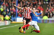 Sunderland midfielder George Honeyman (10) and Portsmouth defender Matthew Clarke (5) during the EFL Sky Bet League 1 match between Portsmouth and Sunderland at Fratton Park, Portsmouth, England on 22 December 2018.