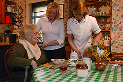 Carers serving breakfast; homecare for the elderly,